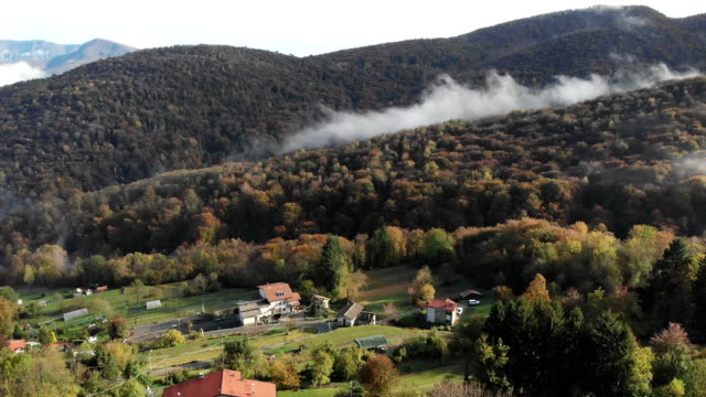 flying over a town and some hill around - lombardia video stock e b–roll