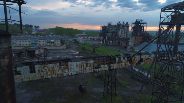 Flying over abandoned ruined elevators. Aerial view. video