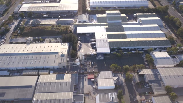 flying over an industrial estate - warehouse aerial stock videos & royalty-free footage