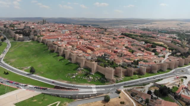 Flying over Avila, Spain. The city has medieval fortification walls. It has the highest number of Romanesque and Gothic churches per capita in Spain. Aerial shot, UHD