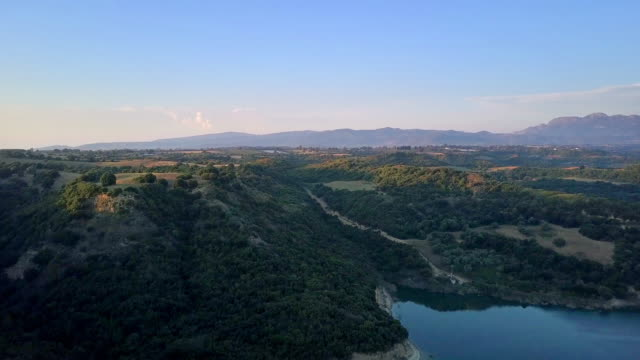 flying over beautiful fields of greece - пелопоннес стоковые видео и кадры b-roll