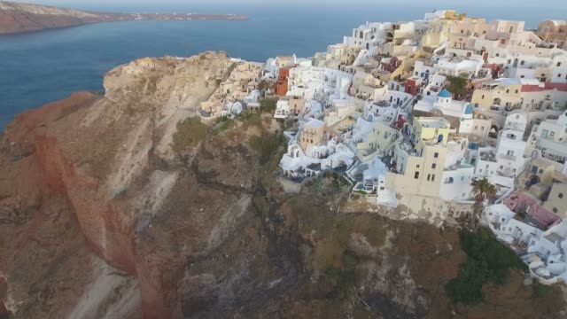 Flying over beuatiful & famous Oia on Santorini Island in Greece during sunrise Flying over beuatiful & famous Oia on Santorini Island in Greece during sunrise aegean islands stock videos & royalty-free footage