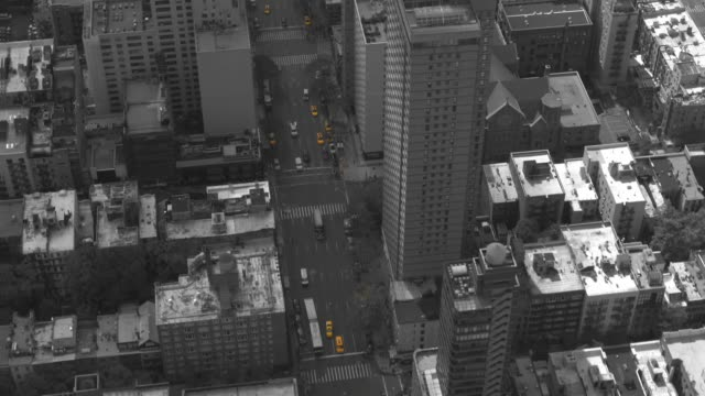 aerial: flying over busy street in new york filled with eye catching yellow cabs - black and white architecture stock videos & royalty-free footage