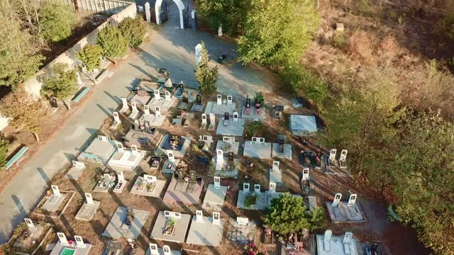 flying over cemetery. new neat and well-groomed graves. entrance