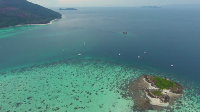 Flying over clean sea and island video