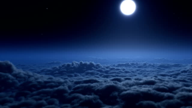 Flying over clouds at night video