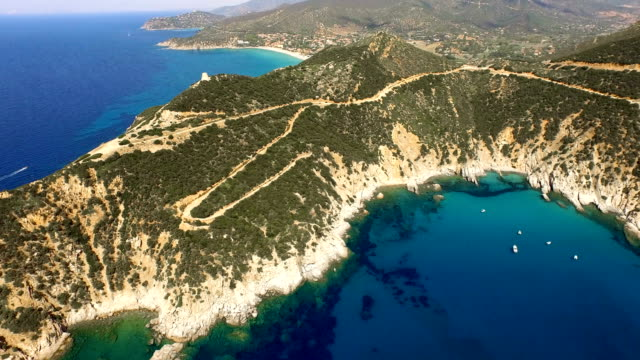 flying over colorful sardinia mediterranean sea coastline at sunrise - sardegna video stock e b–roll
