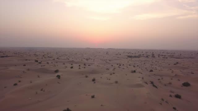 Flying over desert at sunset Flying over desert at sunset desert stock videos & royalty-free footage