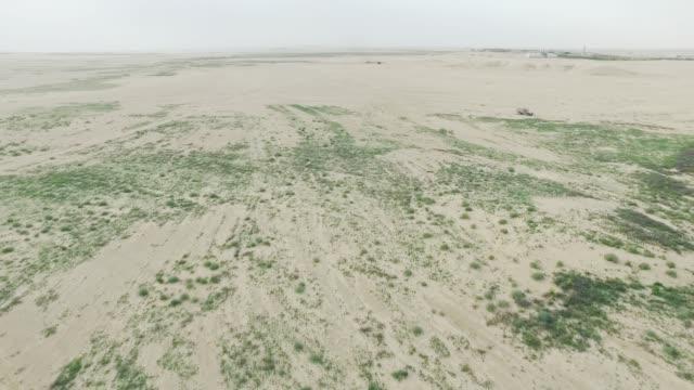 Flying Over Dunes Over Farming In The Desert Stock Video