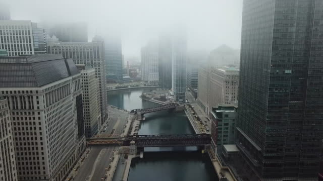 flying over empty chicago river during covid-19 pandemic - space video stock e b–roll