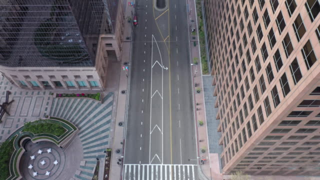 flying over empty downtown street during coronavirus pandemic - california video stock e b–roll
