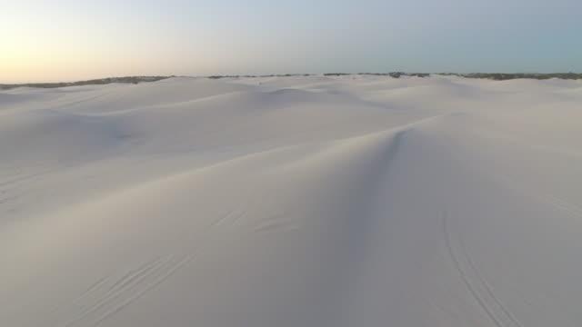 Flying over Endless Sand Dunes in Desert