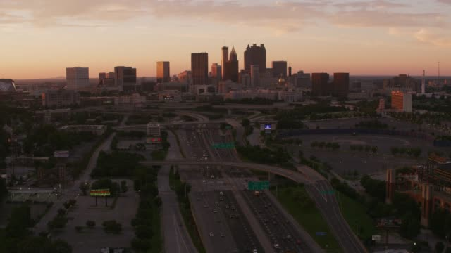Flying over freeways approaching downtown Atlanta at sunset. video