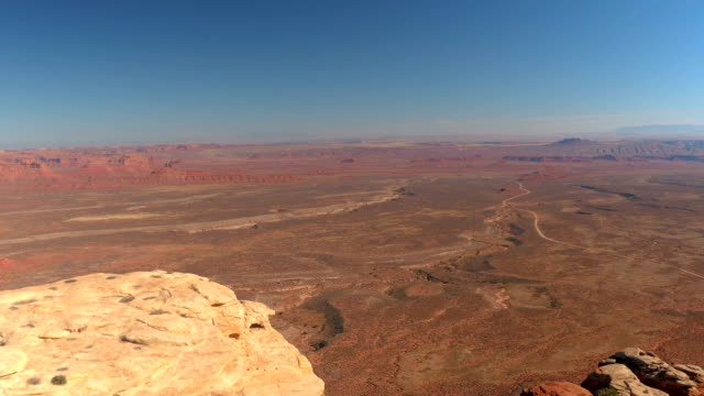 AERIAL: Flying over high red rock tabletop mountain in Valley of Gods, Utah USA video