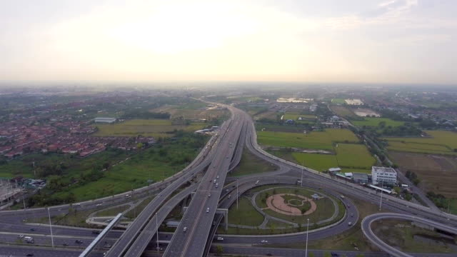 Flying over Highway traffic and circle in Bangkok Thailand, Aerial view video