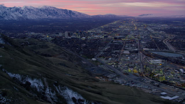 Flying over hills approaching Salt Lake City at sunrise Salt Lake City, Utah circa-2017, Flying over hills approaching Salt Lake City at sunrise utah stock videos & royalty-free footage