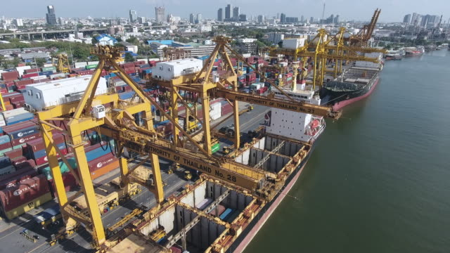 Flying Over Industrial Port with Containers at Morning Sunlight, Aerial video