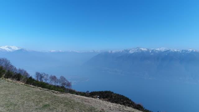 vídeos de stock e filmes b-roll de flying over lake maggiore in switzerland - lago maggiore