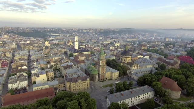 Flying over Lviv City, Ukraine. Town Hall, the tower, Dominican church. Panorama of the ancient city. The roofs of old buildings. video