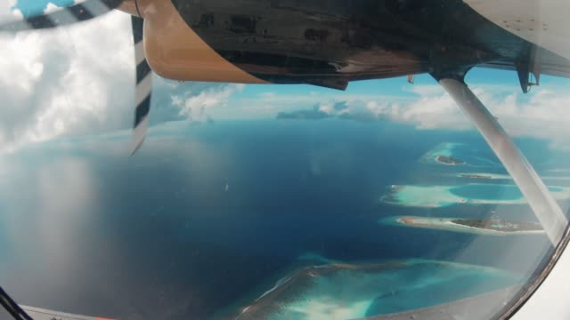 Flying over Maldives Islands with seaplane Flying over Maldives Islands with seaplane propeller airplane stock videos & royalty-free footage