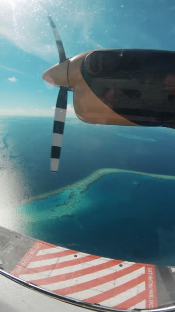flying over maldives islands with seaplane - vertical format video stock videos and b-roll footage