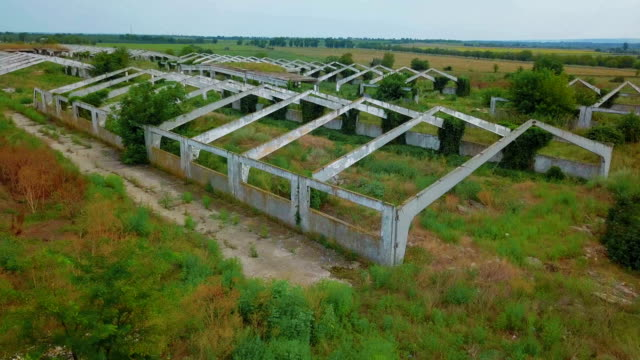 Flying over old abandoned architectural construction at dry field video
