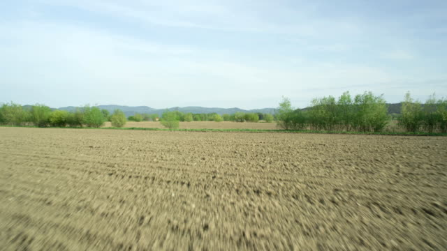AERIAL: Flying over plowed fields in early spring video