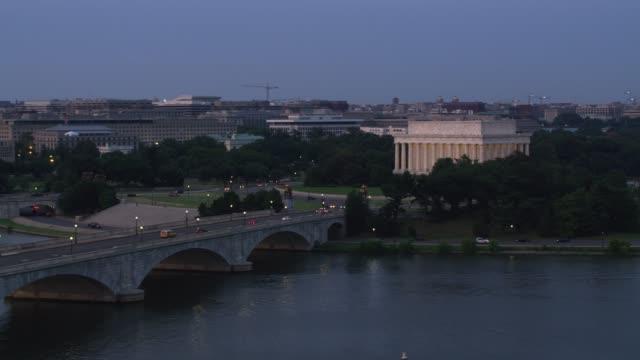 Flying over Potomac River with Arlington Memorial Bridge leading to Lincoln Memorial.