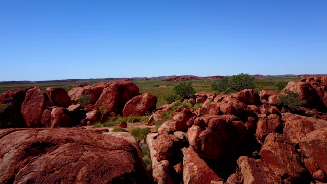 Flying over red boulders and rocks in Australia video