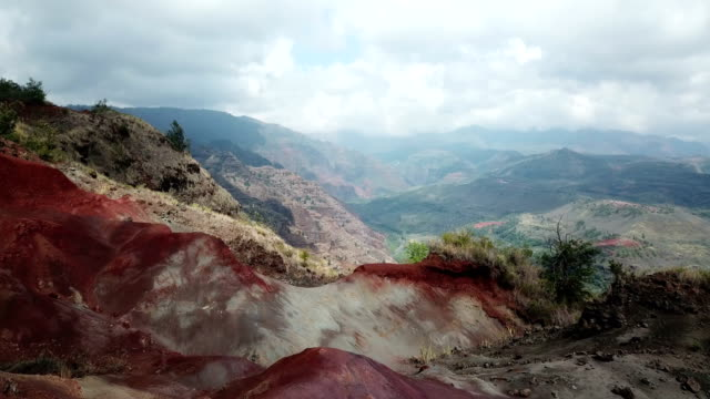 Flying over Red Rocks Toward Massive Valley Below on Island video