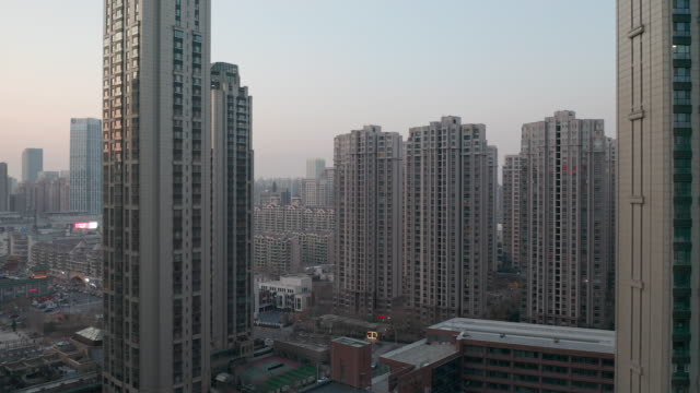 Flying over residential buildings video