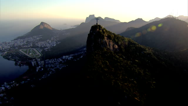 Flying over Rio de Janeiro, Brazil at sunset HD 1080P:  Flying over Rio de Janeiro, Brazil.  Shot with cineflex gyro-stabilized camera system. cristo redentor stock videos & royalty-free footage