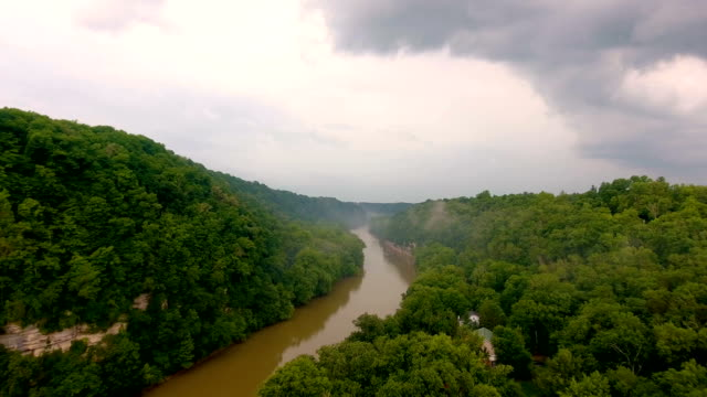 Flying over River Valley in Thunderstorm