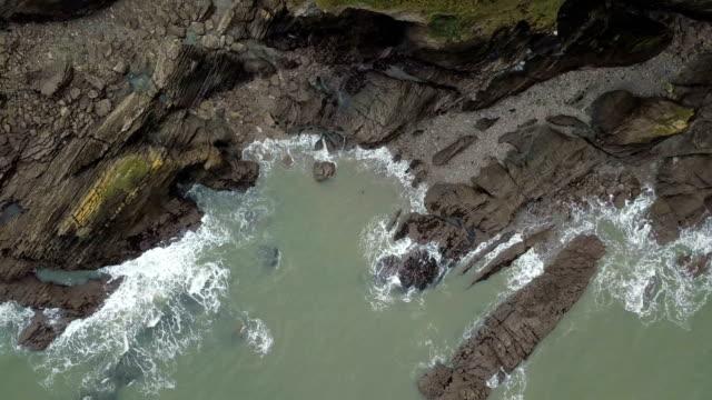 Flying over rocky coastline video