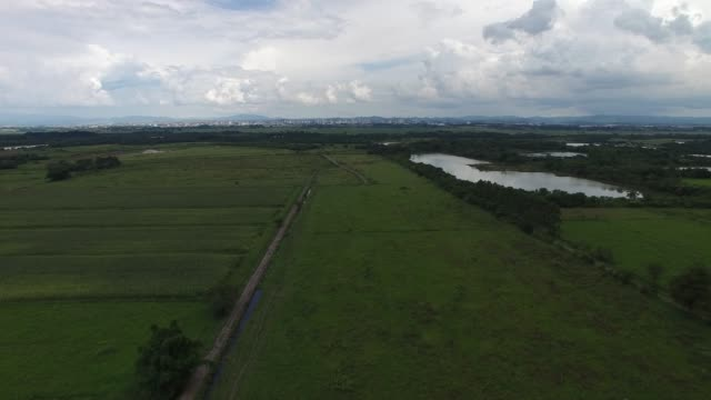 flying over rural area in latin america - парагвай стоковые видео и кадры b-roll