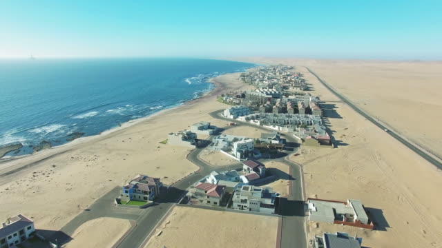 Flying over Swakopmund 4k aerial drone footage of the town of Swakopmund in Namibia swakopmund stock videos & royalty-free footage