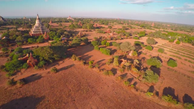 Flying over Temples in Bagan at evening 4k video