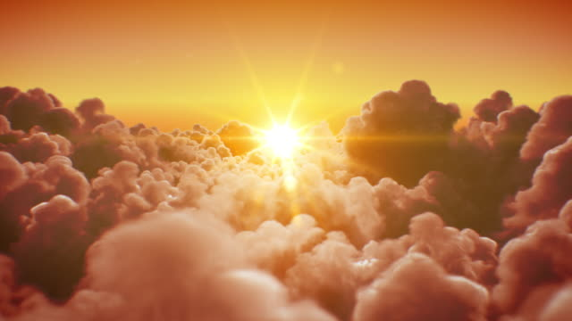 flying over the beautiful infinite clouds with the evening (morning) sun shining bright seamless. looped 3d animation with sunset (sunrise) over the horizon. - angelo video stock e b–roll
