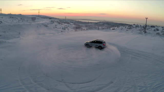 Flying over the car drifting on snow video