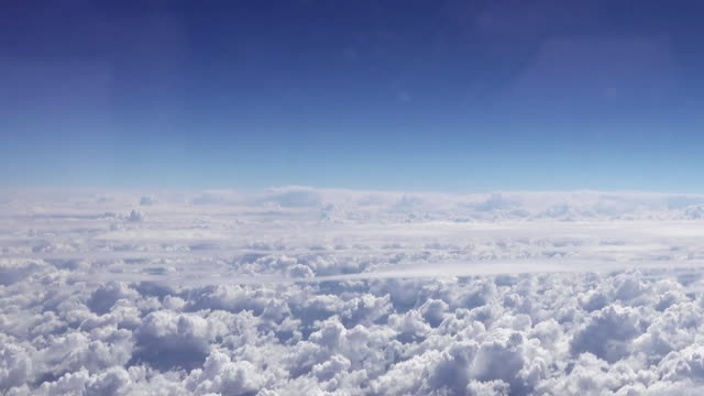 Flying over the clouds. Clouds and skyline view. video
