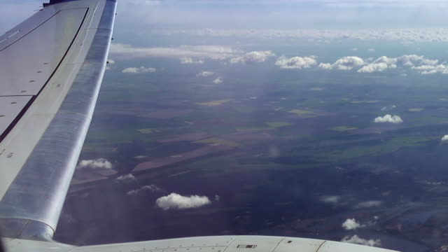 Flying over the clouds in a plane aircraft video
