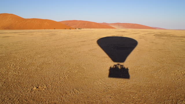 Flying over the desert in Namibia in a hot air balloon Flying over the desert in Namibia in a hot air balloon hot air balloon stock videos & royalty-free footage