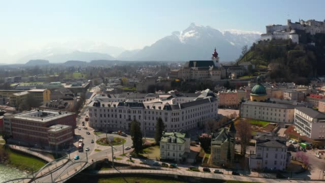 flying over the historic city of salzburg - barocco video stock e b–roll