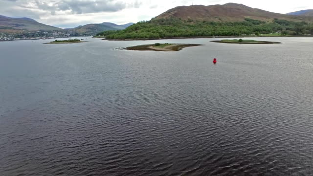 Flying over the Loch Linnhetowards the famous locks in Fort William Flying over the Loch Linnhetowards the famous locks, Scotland, United Kingdom horn of africa stock videos & royalty-free footage