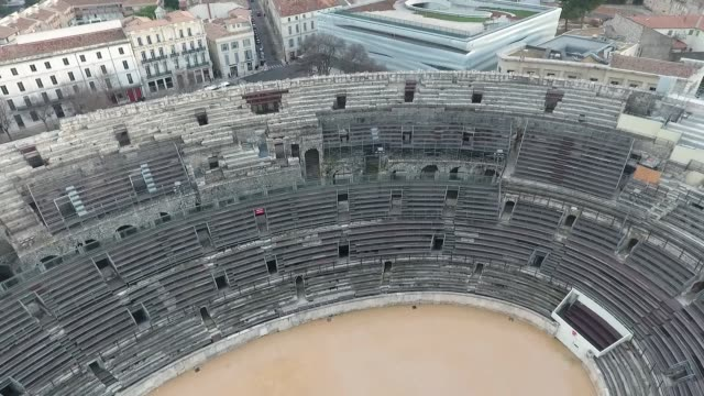 Flying over the old Roman amphitheatre in the city of Nimes