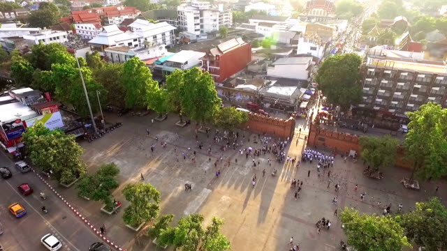 Flying over the Thapae gate, antique famous landmark of city in Chiang mai, Thailand.