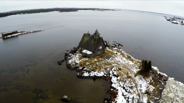 Flying over the township on coast in winter video