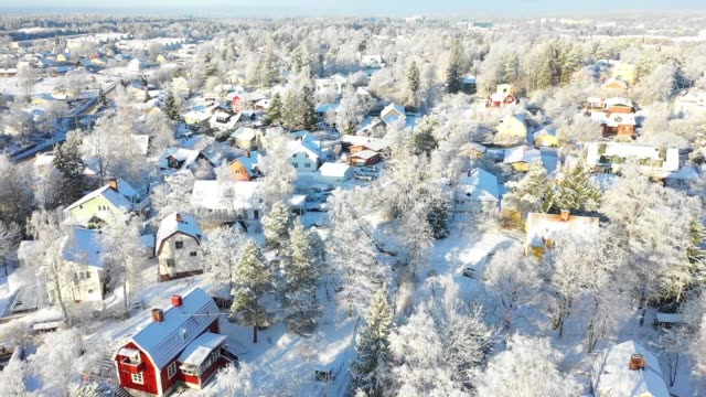 Flying over villa area, winter day Flying over villa area, winter day stockholm stock videos & royalty-free footage