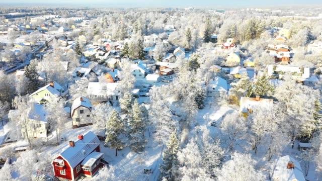 flying over villa area, winter day - zima filmów i materiałów b-roll