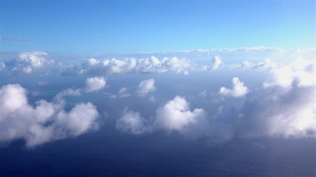 4K AERIAL CLOSE UP: Flying pass and through beautiful white clouds on a clear sunny day above vast Pacific ocean 4K AERIAL CLOSE UP: Flying pass and through beautiful white clouds on a clear sunny day above vast Pacific ocean propeller airplane stock videos & royalty-free footage
